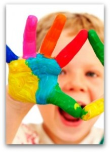 young kid with paint on his hands