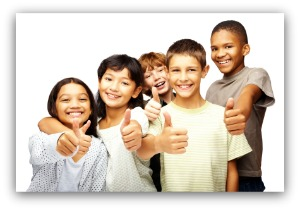 Happy kids, smiling, and thumbs up over white background